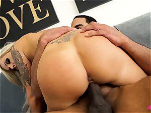 huge-chested blonde Nina Elle taking a huge black spunk-pump
