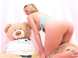 Brett Rossi plays with a inserted bear's strap-on fake penis