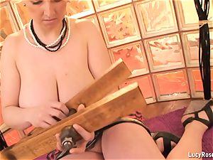 Wooden squeezer on her hefty knockers