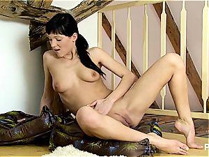 Sandra frigs herself on wooden floor