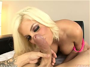 Alluring Britney Amber munches down this nail stick